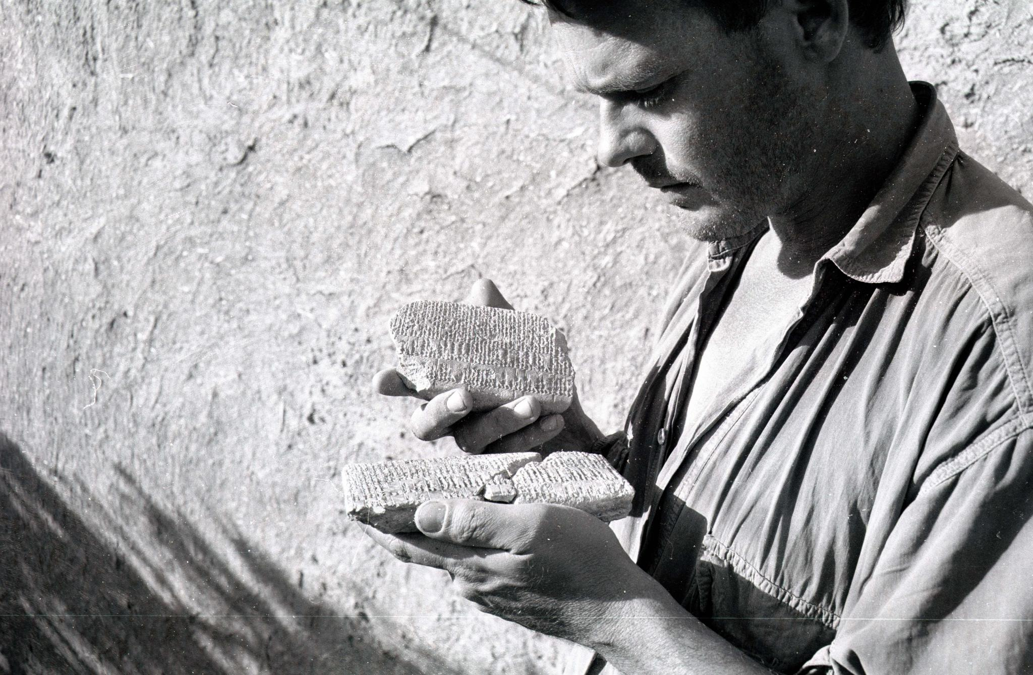 Peter Akkermans studying two clay tablets found at Tell Sabi Abyad